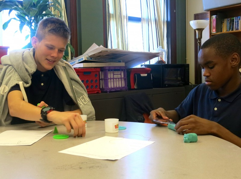 Eighth graders at Taft Junior High in Oklahoma City work together to discover the relationship between geometric planes and solids.