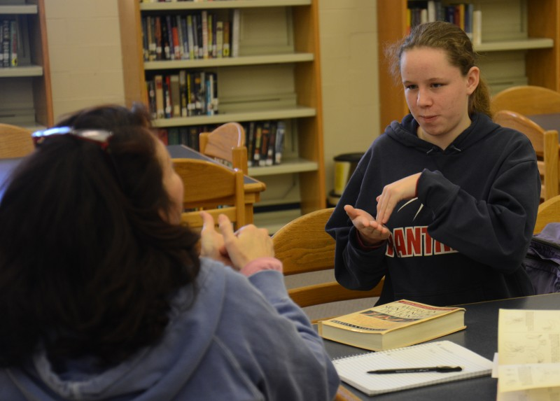 Pittsfield Middle High School student Meredith Smith is tutored in American Sign Language by Liz Hitchcock, one of the community partner volunteers in the school's Extended Learning Opportunities program.
