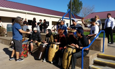 Students use a break between classes at Bowman High School for a drum circle.