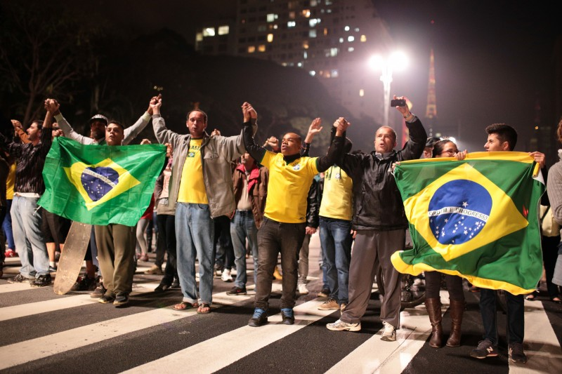 JULY 13, 2014 - Protesters stop the traffic in Paulista Avenue for only a few minutes during a protest against corruption, for improvements in public services and against the money spent on the 2014 World Cup in front of the Art Museum of Sao Paulo (MASP).