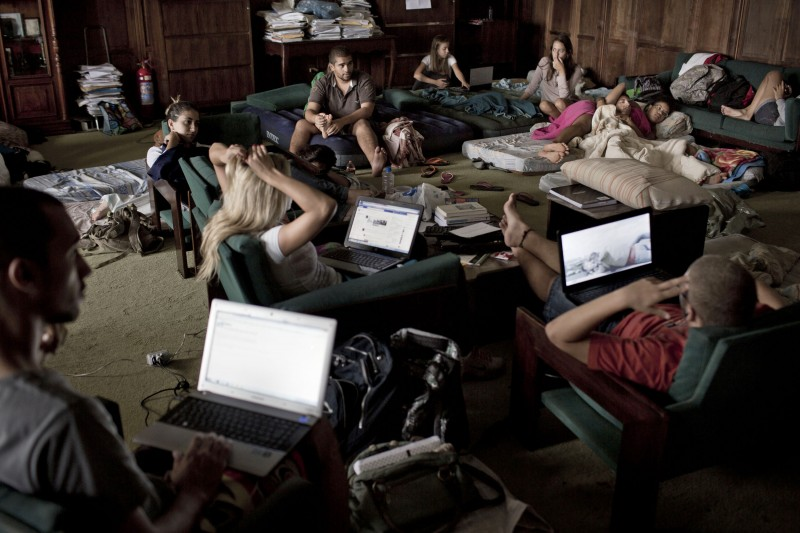 In this March 27, 2013 photo, students occupy the administrative offices of the Rio de Janeiro Rural Federal University, UFRRJ, to protest the school's conditions in Seropedica, Brazil. Laboratories routinely flood when it rains, lecture halls reach oven-like temperatures because the burned-out AC units were never replaced, the Internet works only intermittently and students hardly dare venture out after dark for fear of being mugged.