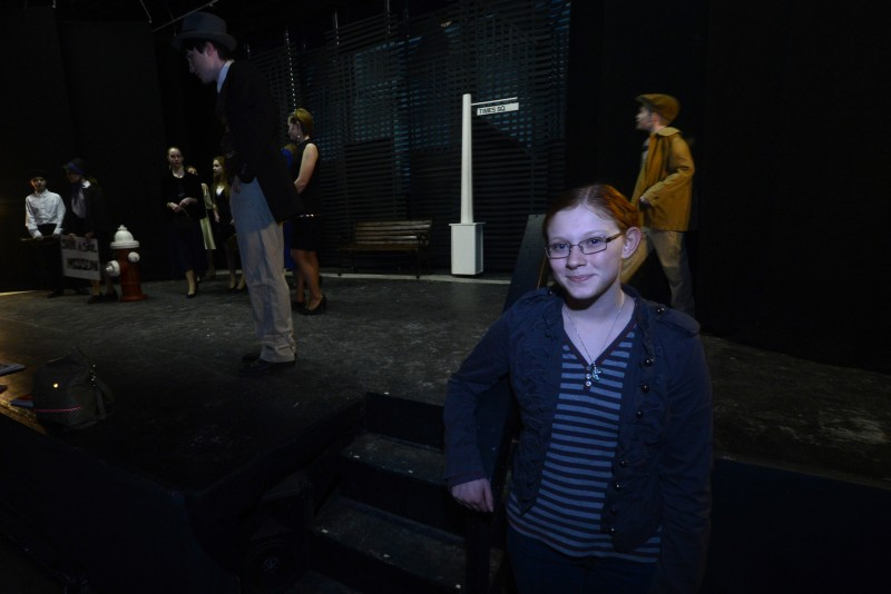 Freshman Emily Dunnigan watches rehearsal backstage at the Pittsfield Players Theatre, where she's earning school credit for a workplace internship.