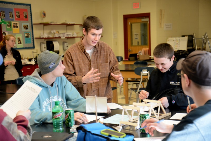 Left to right: Pittsfield Middle High School students Dana Hudgens, Ryan Marquis and Eli Johnson work on a construction project. Marquis, a senior, designed the lesson for his classmates as part of his engineering career internship.