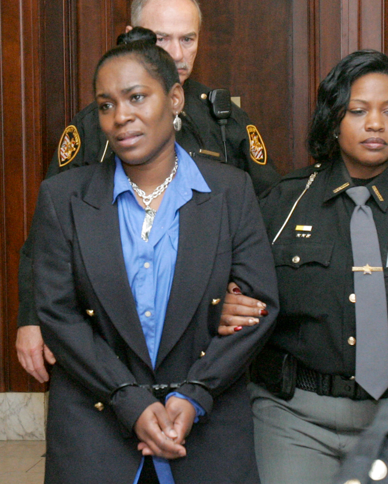 In this Jan. 18, 2011 photo, Summit County Deputies escort Kelley Williams-Bolar out of the courtroom after she was sentenced to 10 days in the Summit County Jail, three years of probation following her release and 80 hours of community service in the Summit County Courthouse in Akron, Ohio. Williams-Bolar was found guilty of two third-degree felonies for having her children attend Copley schools while being an Akron resident.