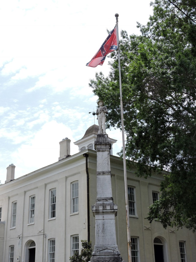 Confederate flag flies outside of Carroll County courthouse, alongside Confederate soldiers' memorial.