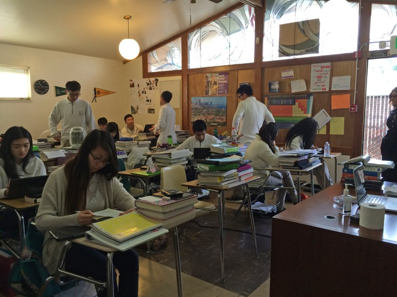 High School students at the American Indian Model Schools work in small classrooms at desks piled high with Advanced Placement textbooks.