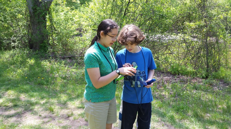 Ben Pratt and Joline Maher, 7th graders at Diamond Middle School in Lexington, Mass. They are working on field notes about their measurements of dissolved oxygen in Parker Meadow Pond.