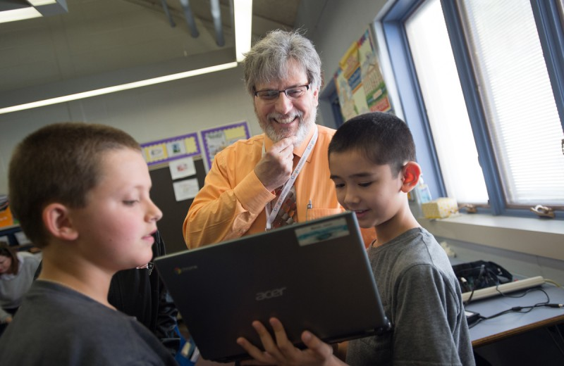 Greenbush elementary school fourth-grade students Jaden Nerola, right, and Connor Moreau, left, show Director of Technology Jim Monti a tool they created on their Chromebooks.