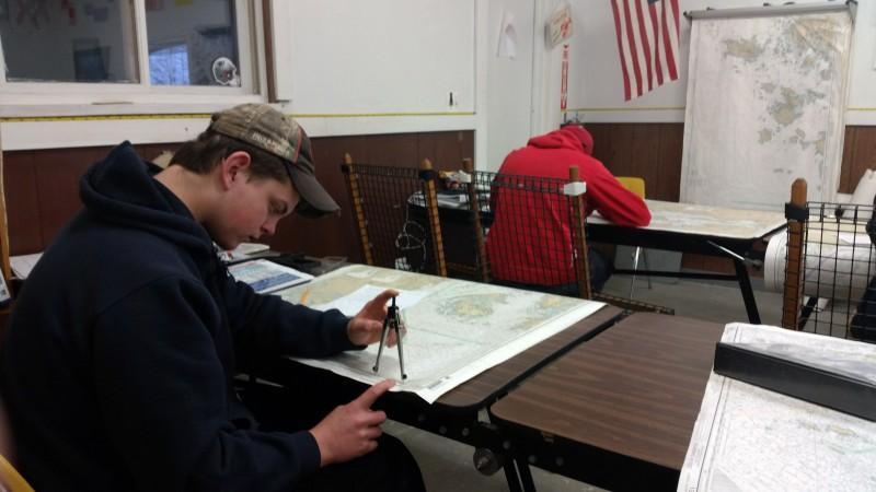 Elliot Nevells takes a test on navigation in his marine trades class. The Deer Isle-Stonington High School freshman says before he knew about the school's marine studies program, he thought he'd probably drop out of high school. Photo: Sarah Butrymowicz