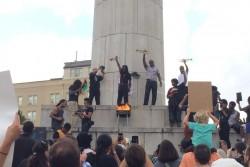 Burning of the Confederate flag - May 25 at Robert E. Lee Circle, New Orleans.