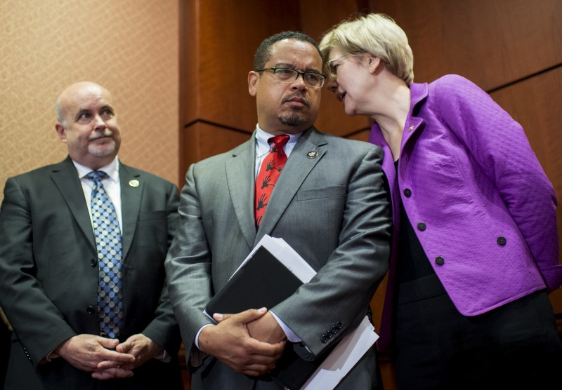 From left, Rep. Mark Pocan, D-Wisc., Rep. Keith Ellison, D-Minn., and Sen. Elizabeth Warren, D-Mass., talk during the press conference in the Capitol to call for the elimination of student loan debt at public higher education institutions on Wednesday, June 10, 2015. Reproduction is not permitted.