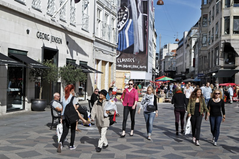This is a Aug. 27, 2012, file photo of tourists strolling the shopping street Stroeget, in Copenhagen Center, Denmark.