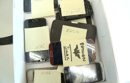 Smartphones that students from London's Capital City Academy surrendered for a week earlier this spring for the disCONNECT project.