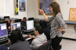 Classroom volunteer Aimee Menne helps teach one of the only computer science classes currently offered at San Francisco's Mission High.