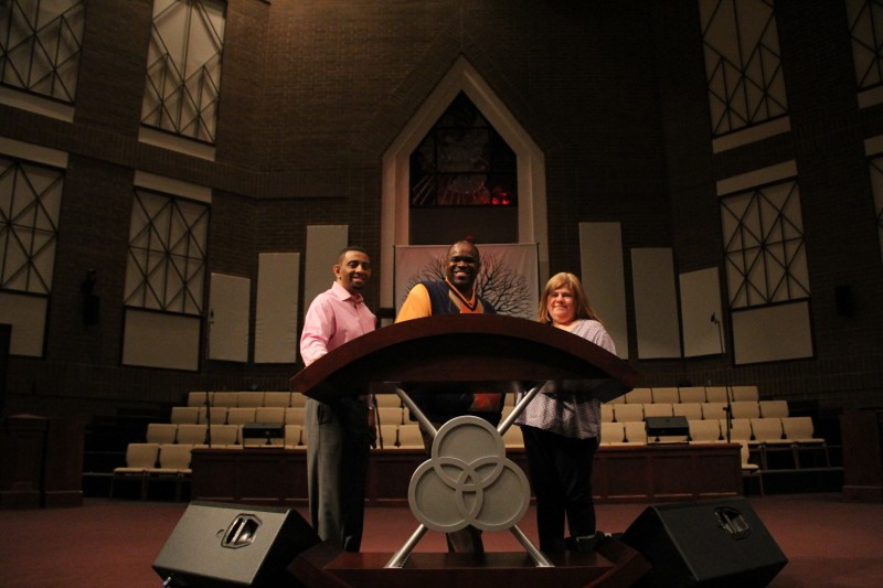 James Brooks, director of marketing at Mount Zion Baptist Church, Degrees Matter! associate director Camy Sorge, and pastor Odell Cleveland work together to encourage members of the congregation to return to school.