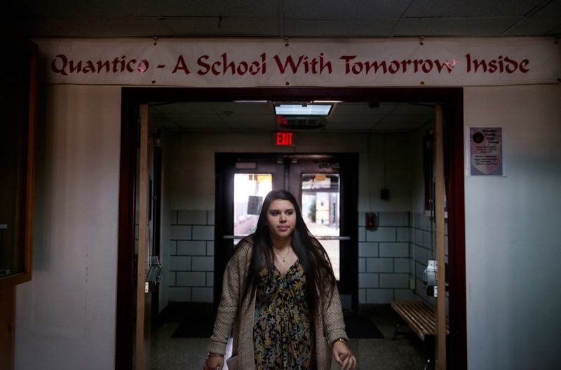 Senior, Jessica Brown, passes though the halls of Quantico Middle/High School in between classes on March 13, 2015 in Quantico, VA.She plans to enlist in the U.S. Navy later this summer.