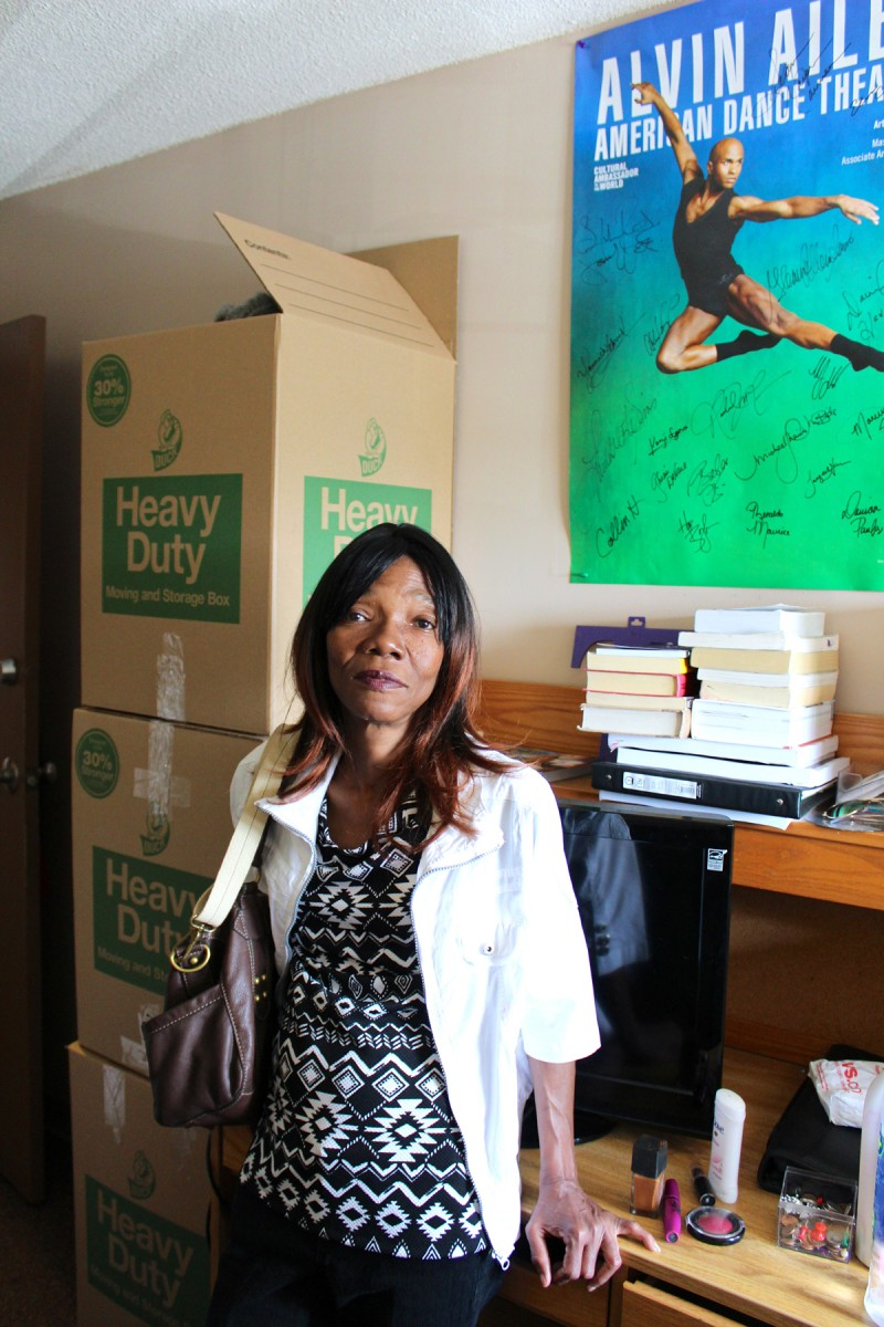Geneva Halley stands amid the moving boxes in her daughter's dorm room. When she and her two daughters fled Katrina's floodwaters, they had little time to pack.
