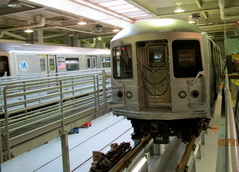 Students at Transit Tech High School work on retired New York City subway cars that are permanently parked inside the school.