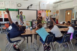 """Students meet with the center's creative director Shirl Buss and representatives from the National Organization of Minority Architects as part of the school's revitalization efforts. Buss tells the students to """"talk up"""" their ideas."""