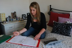 Second grade teacher Megan Winslow, 33, reviews student work at her home in San Jose. Winslow, who has taught for nine years, shares a $2,515-a-month two-bedroom apartment with a roommate.