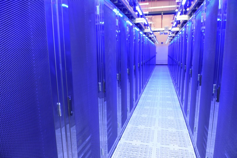 A 10,000 square foot server room highlighted in blue LED lighting.
