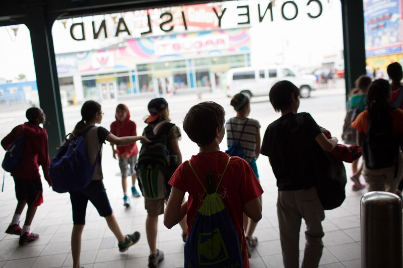 Etai Kurtzman, 12, center, and his group of Quest to Learn school students arrive at Coney Island.