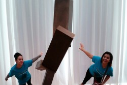 Kelsey Hunt, left, and Harley Graham, right, students from Fairmont High School in Fairmont, North Carolina, pose with Joel Shapiro's 'Untitled' as part of a virtual exhibit they created during a