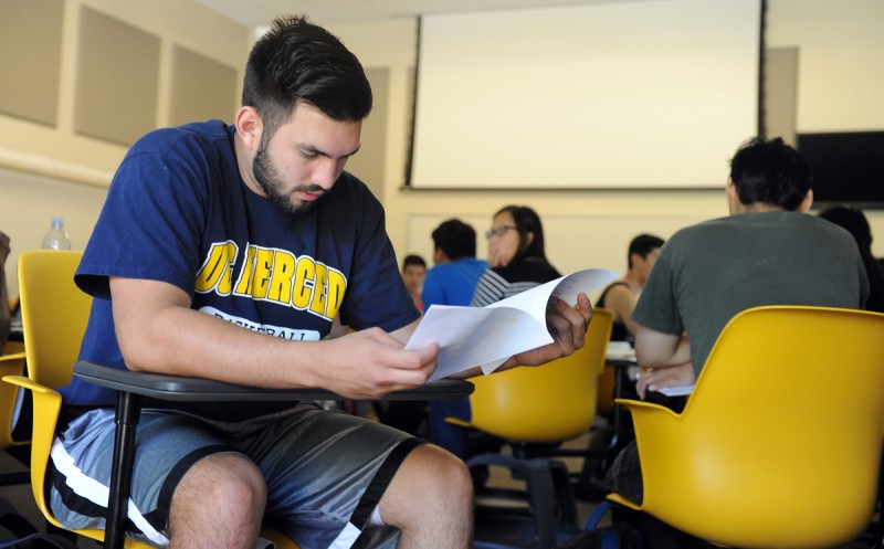 UC Merced student James Reed goes over some notes for his marketing class.
