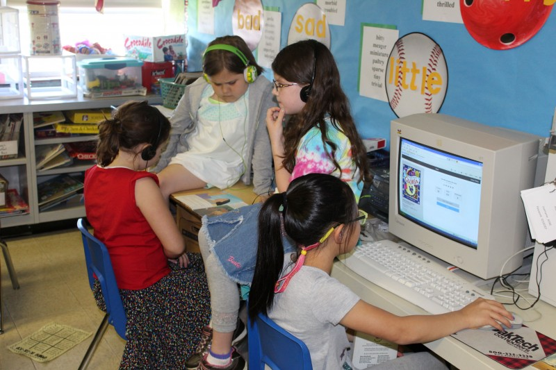 Students in Corey Gilman's second-grade class use a mix of old-school and new technologies in the classroom.