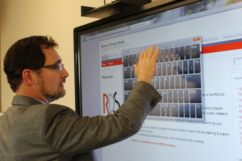 Matt Stuve tries out the latest in smart televisions from Apple in one of five innovative smart classrooms at Ball State.