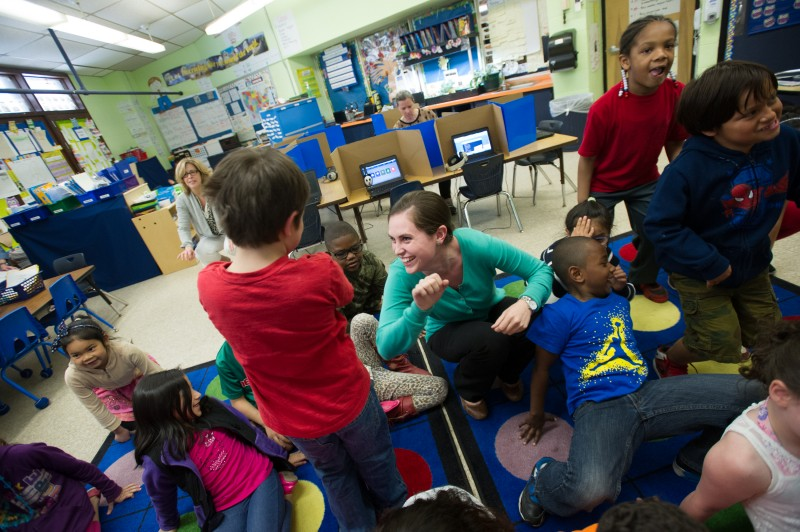 Pleasant View Elementary School teacher Alex Gibbons, center, dances with her students during a transition between lessons in her class this past May.