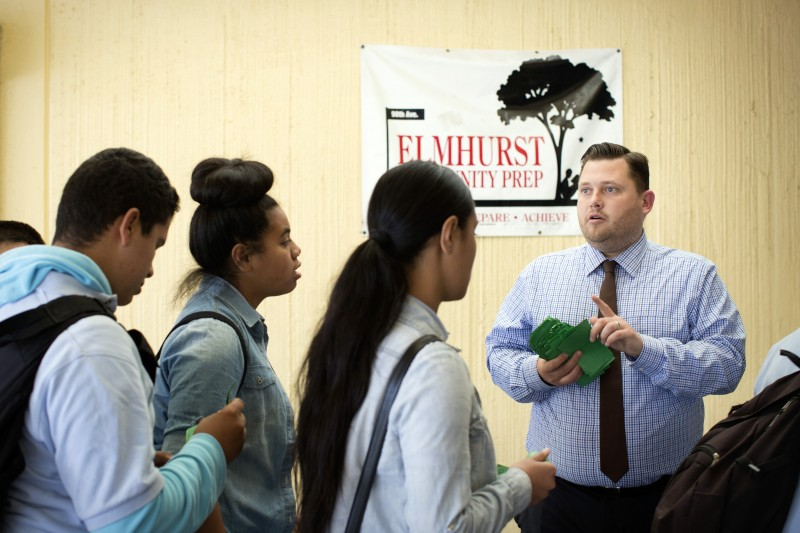 Kilian Betlach, right, principal of Elmhurst Community Prep Middle School, monitors the lunch line on Monday, June 1, 2015 in Oakland, Calif.