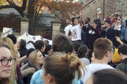 Yale University students and supporters participate in a march across campus to demonstrate against what they see as racial insensitivity at the Ivy League school on Monday, Nov. 9, 2015, in New Haven, Conn.
