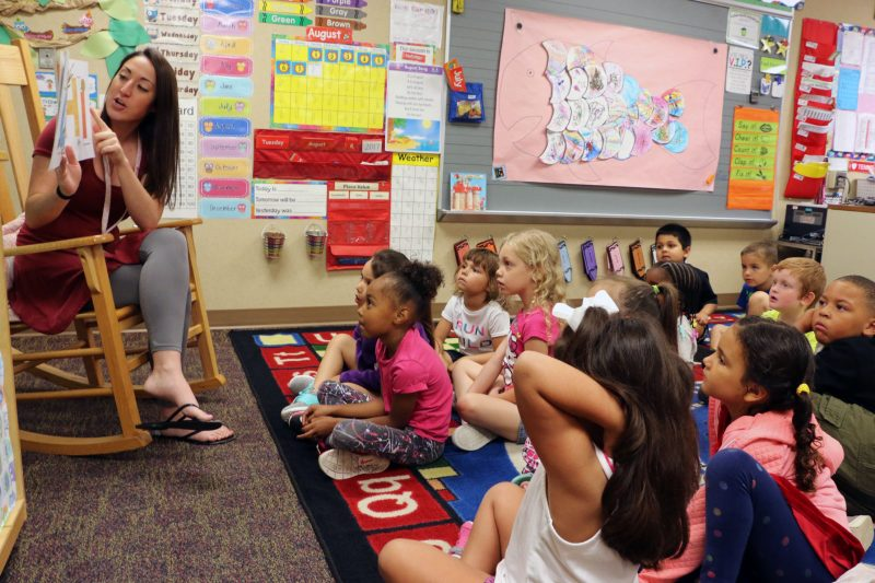 Miami Elementary School kindergarten teacher Ashleigh McCord reads to students during pre-K camp.