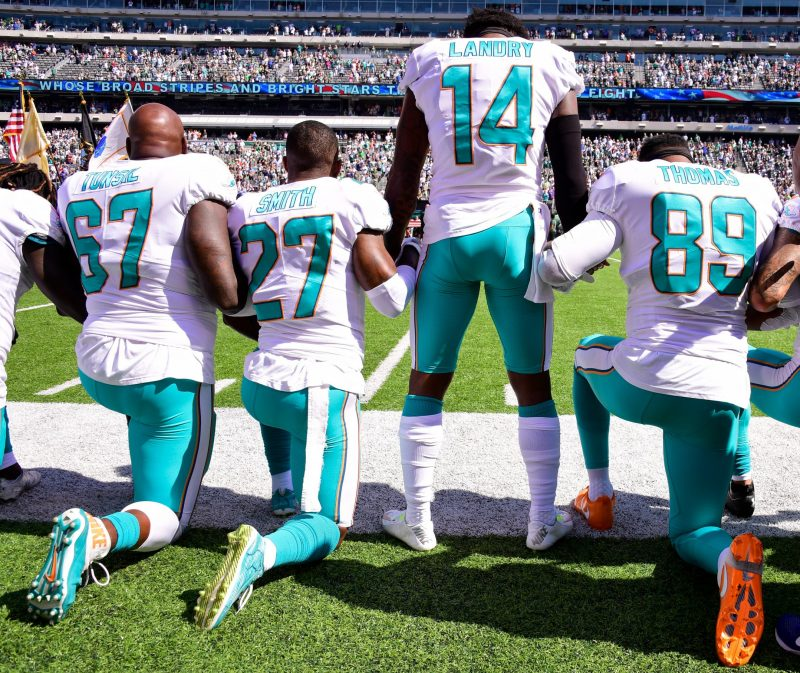 The Miami Dolphins during the National Anthem on September 24, 2017 in East Rutherford, New Jersey.