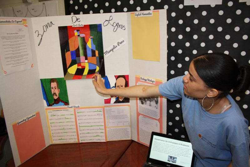 "Manyelis Peña presents during ""Zona de Logros,"" or ""Achievement Zone,"" an annual spring event at which Muñiz Academy students describe their best work from the year in Spanish and English."
