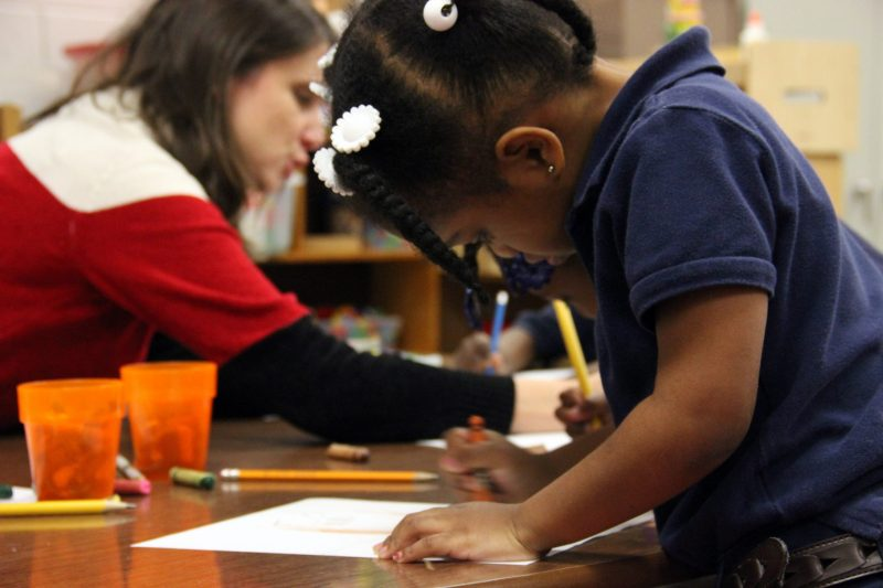In this file photo, a pre-K student completes a writing assignment.