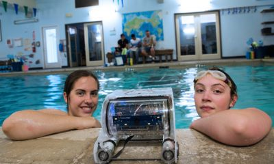 A robot built by students to research endangered frogs in Lake Titicaca, in Peru, being tested in June, 2016, by Lindsey Hamblin, then a Skyline High School senior, and Callie Meyers, then a Skyline junior.