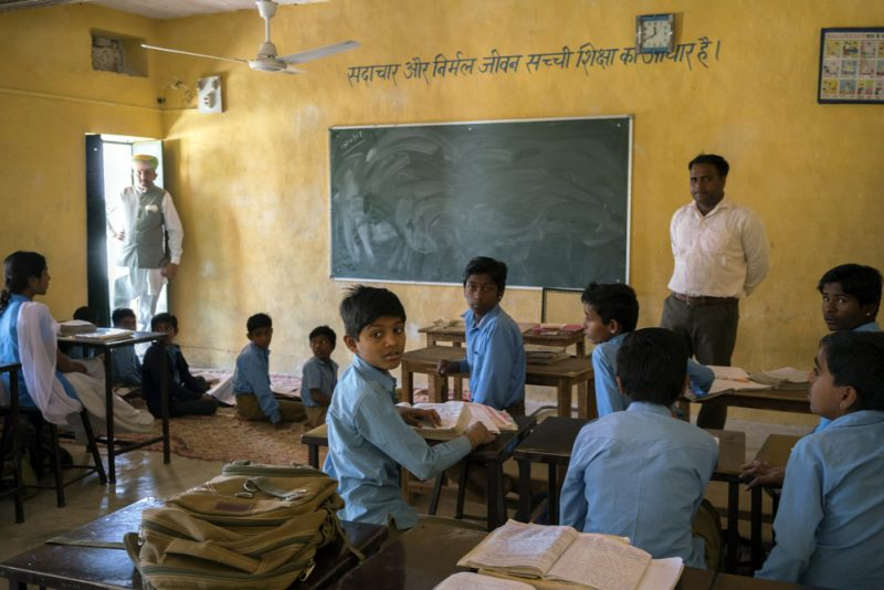 Inside a classroom at a government school where there aren't enough desks.