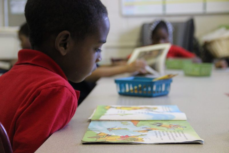 In this file photo, a student at a Mississippi elementary school reads during class.
