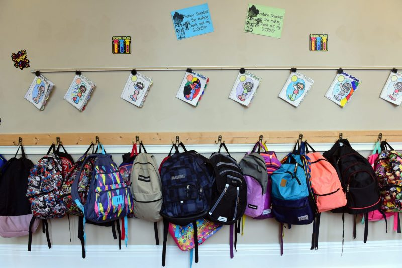 Backpacks hang from the wall in a New Orleans school.