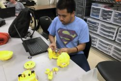 A student at the St. Vrain Valley School District's Innovation Center putting together a robot after school.