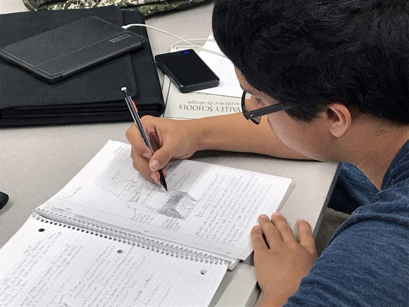 A student at Skyline High School works on his sketch to create a solar oven.