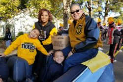 Grambling State University President Richard Gallot, Jr. (pictured right) rides in the homecoming parade in Grambling, LA with his wife Christy Gallot and sons.