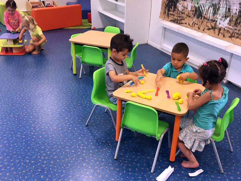 Students learn motor skills and shapes by playing with clay in this 2-year-old classroom in Lormont, a suburb of Bordeaux.