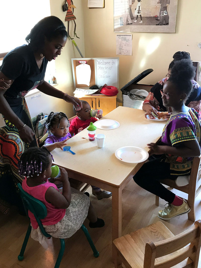 Lorna Parks serves lunch at her home-based child care program, called House of Joy, in Detroit. Most home child care programs include a midday meal, usually prepared by the owner.