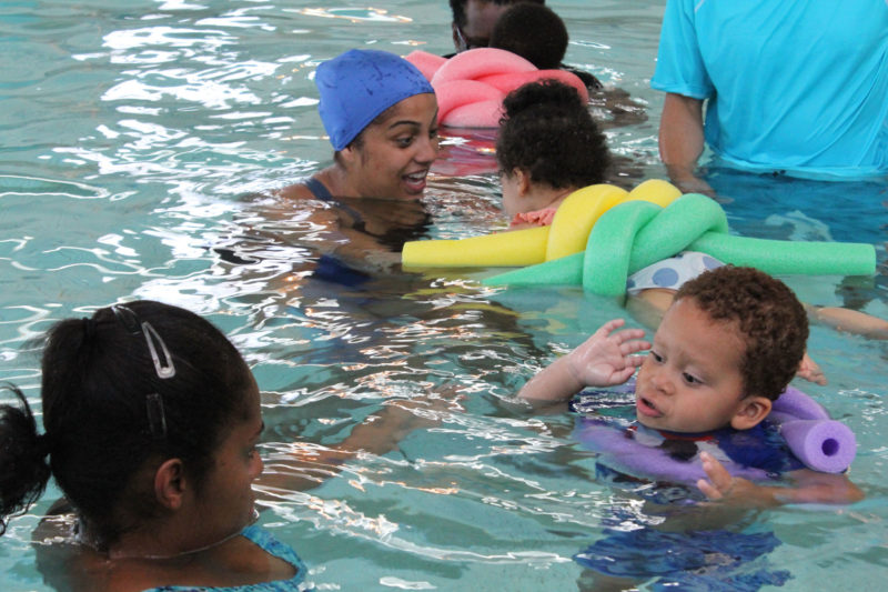 Toddler Jonathan Cruz swims with his mother, Jennifer Cruz, left, at a lesson in East Harlem organized by Reach, a program that serves kids with special needs.