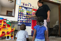 Kanetha Brown goes over the days of the week with her charges at her home-based child care program in Wichita, Kan. Brown has training as an educator, but knows of other home-based care options where kids learn little during the day. Most states only require a high school diploma to run a home-based child care facility.