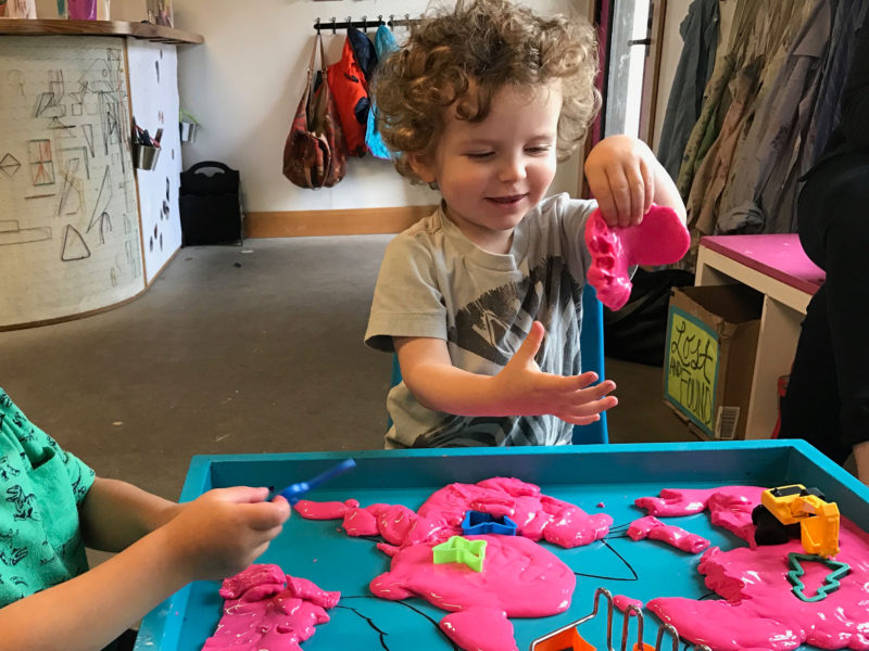 "Clark Tinker, age 2 in this photo, holds up some ""oobleck,"" a concoction made out of cornstarch and water, at a play space in Portland, Ore. Sharing toys and other play materials is a tough task for 2-year-olds."