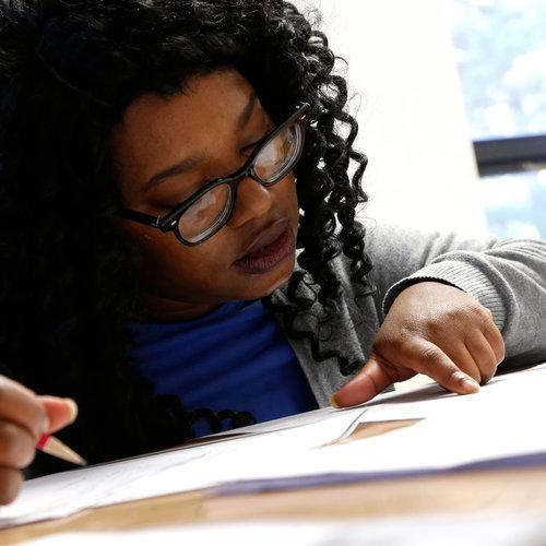 Kenyatta Burn works with her tutor at the Durham Literacy Center on Thursday, Nov. 20, 2017, in Durham, N.C.